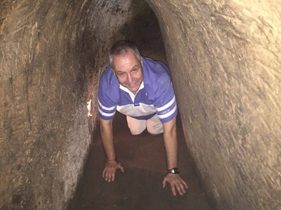 Going through tunnels at Cu Chi on a tour with a war expert