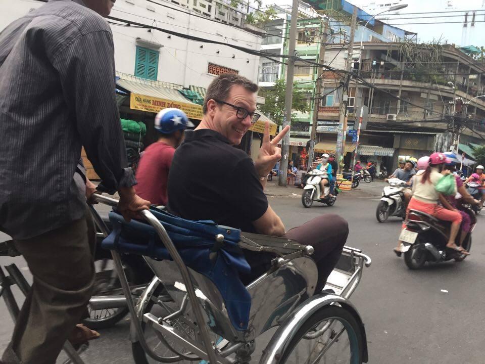 Going around HoChi Minh city on a cyclo